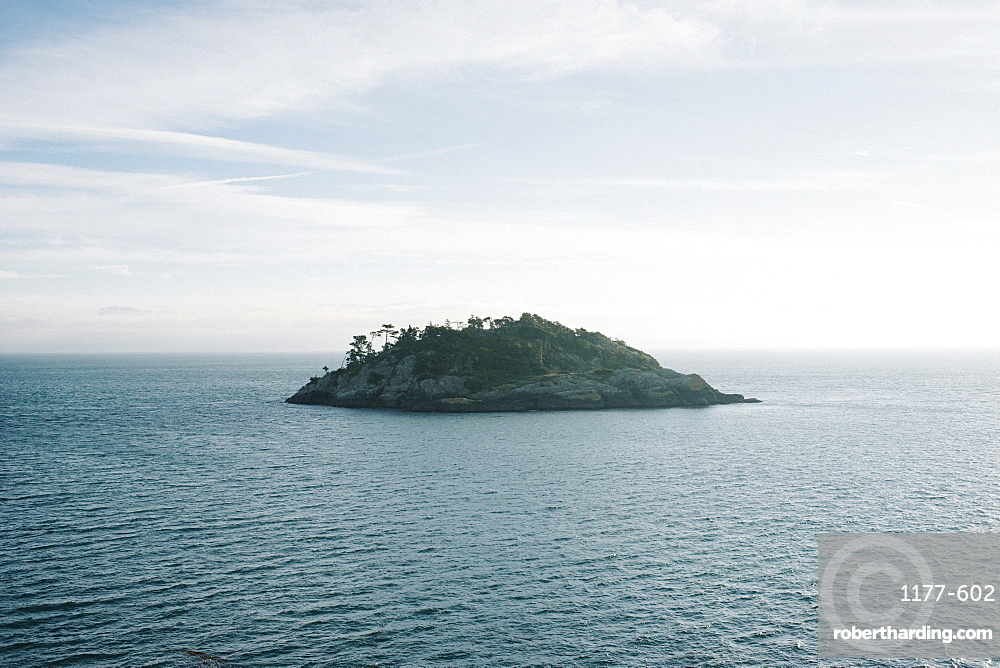 Island in middle of sea against sky
