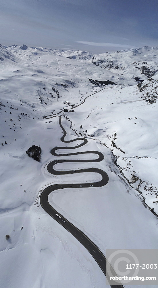 View from above winding road through snow covered mountain, St. Moritz, Switzerland