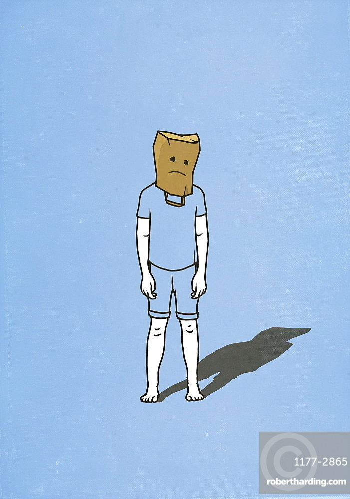 Sad man with paper bag over head