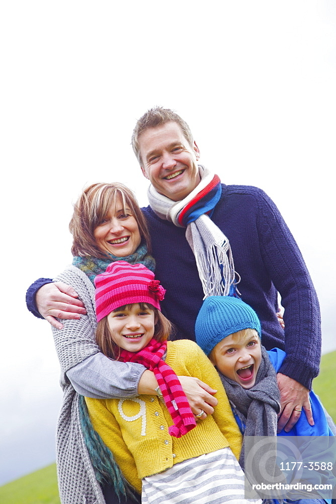 Portrait happy family in hats and scarves