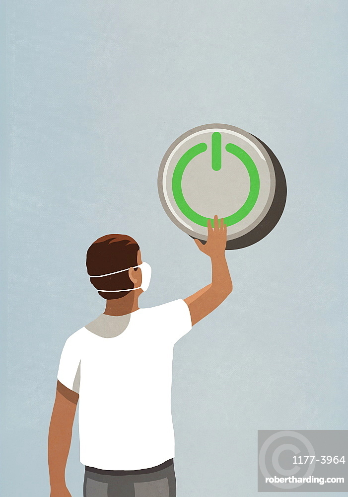 Man in face mask pushing large green power on button