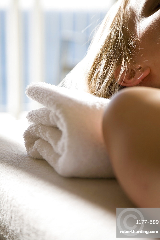 Close-up of a woman lying down on a massage table