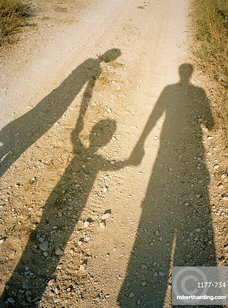 Shadow of a family holding hands