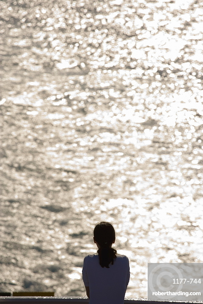 A woman looking at to sea