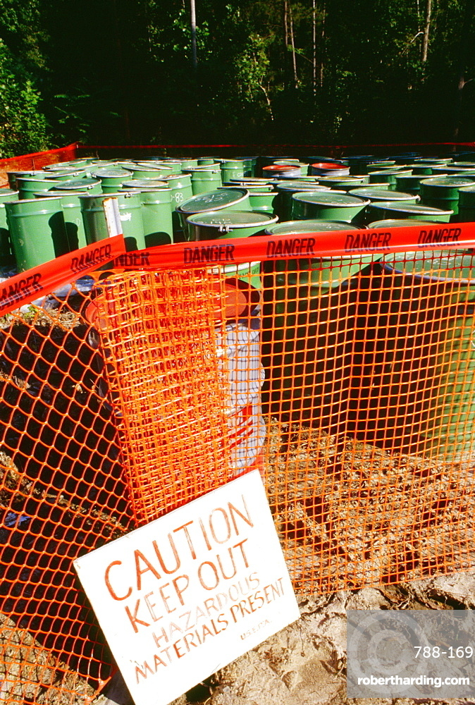 Warning sign in front of barrels of toxic waste, Virginia, USA