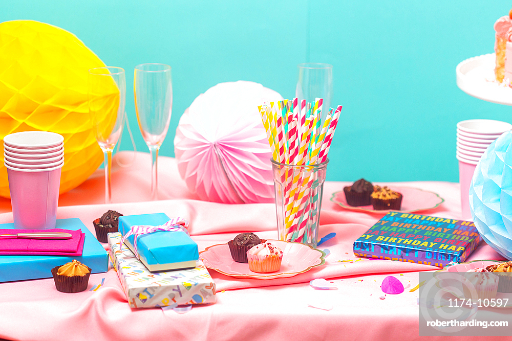 Birthday party table, with pink tablecloth