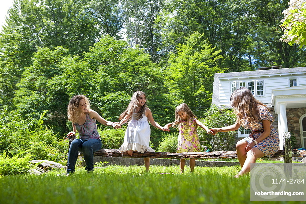 Family playing in the garden in summer.