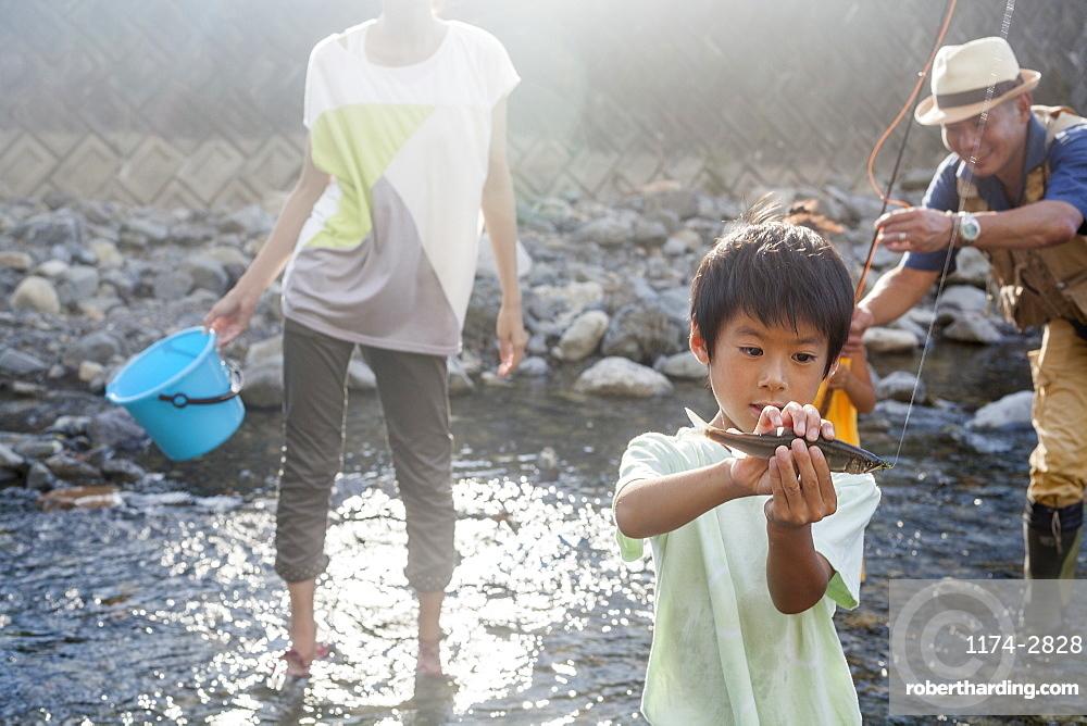 Family fishing in a stream, Kyoto, Honshu Island, Japan