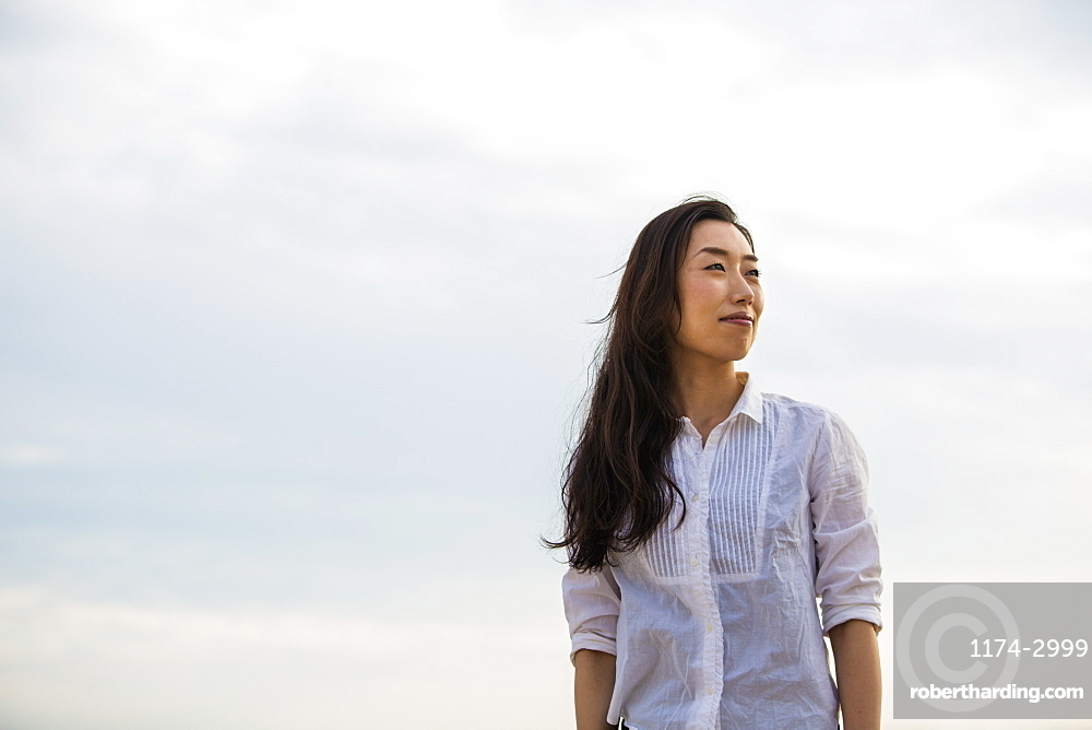 A woman on a beach in Kobe, Kobe, Japan