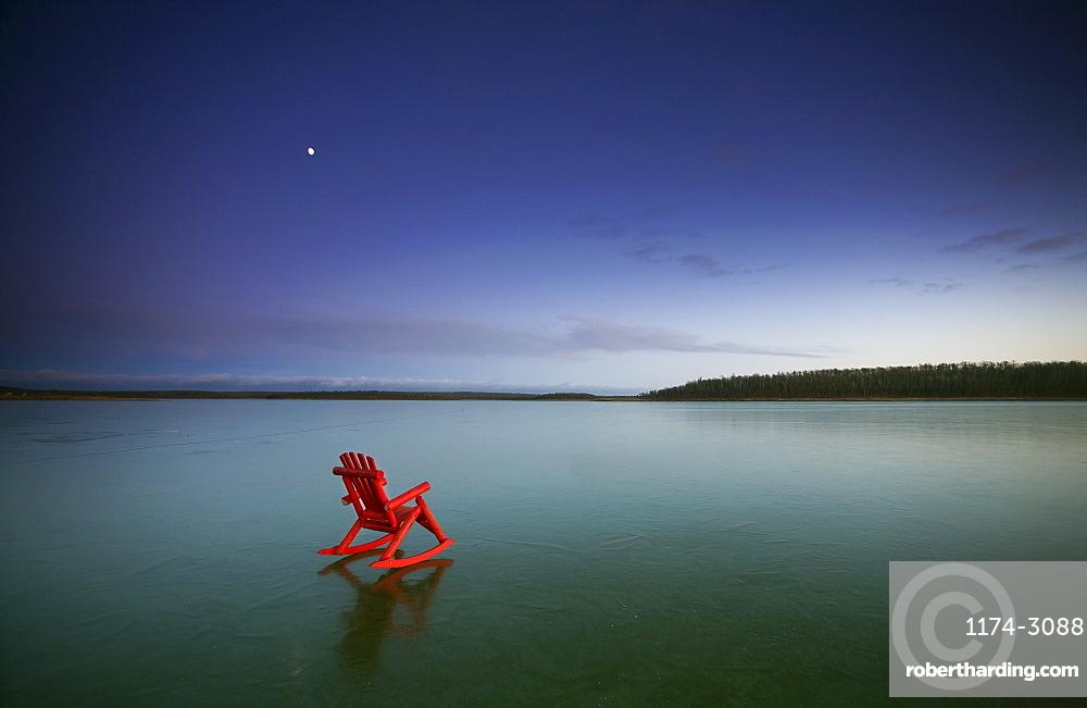 A small red rocking horse, on a frozen lake, Lake, Saskatchewan, Canada