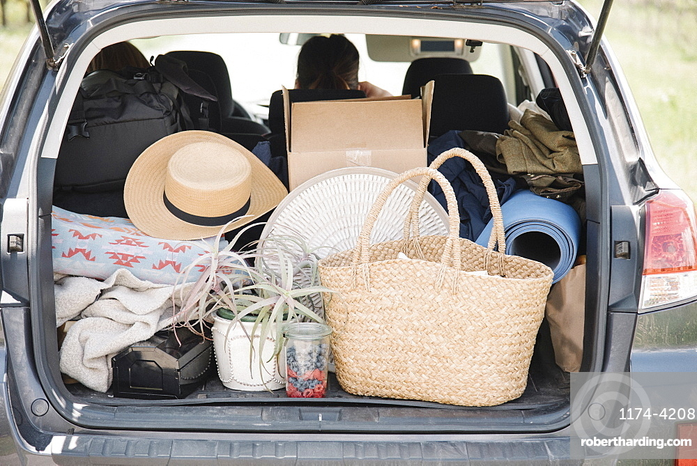 An estate car trunk full of bags and belongings, United States of America