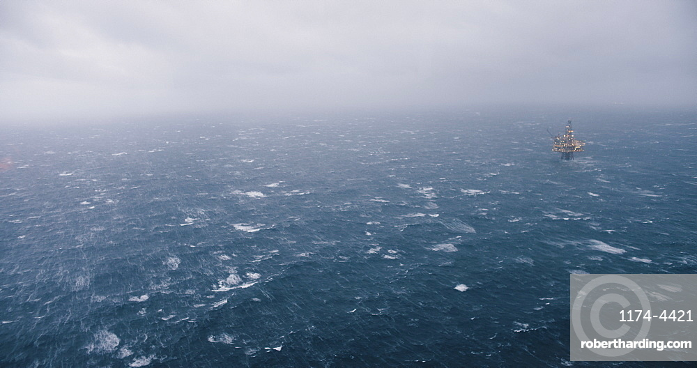 A ship sailing in the North Sea in foggy, rough conditions.
