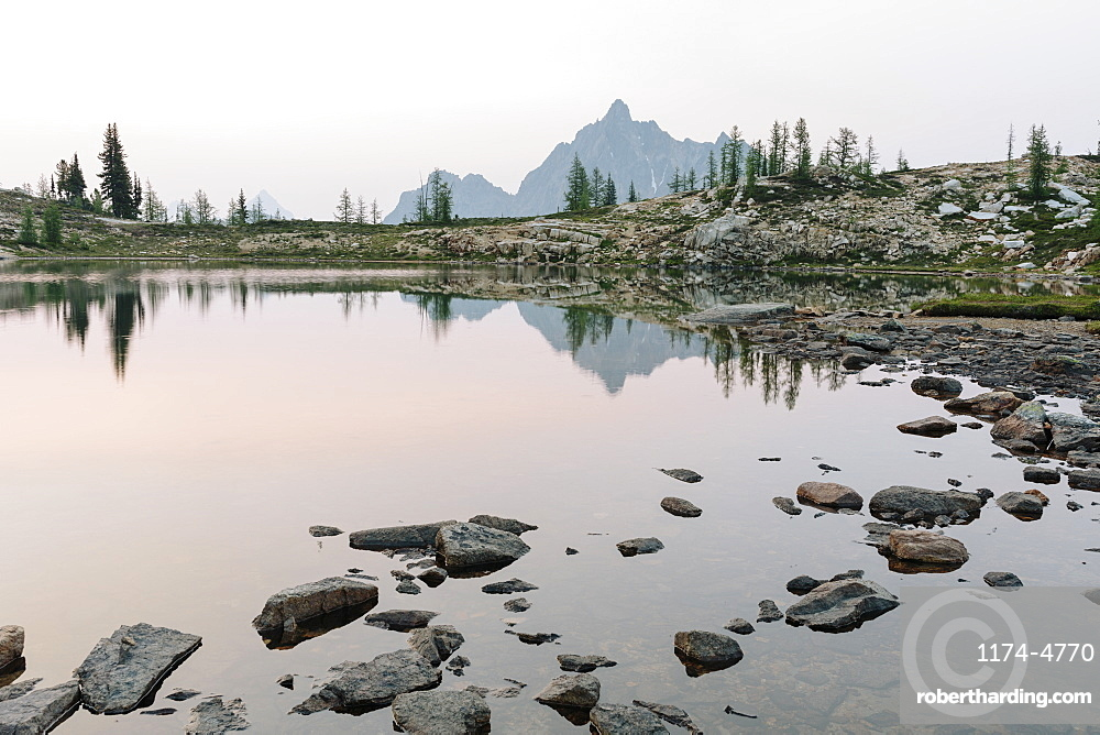 Alpine lake at dusk, Snowy Lakes, along the Pacific Crest Trail, North Cascades, Washington, United States of America