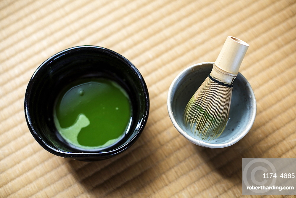 Tea ceremony utensils including bowl of green Matcha tea and bamboo whisk, Kyushu, Japan