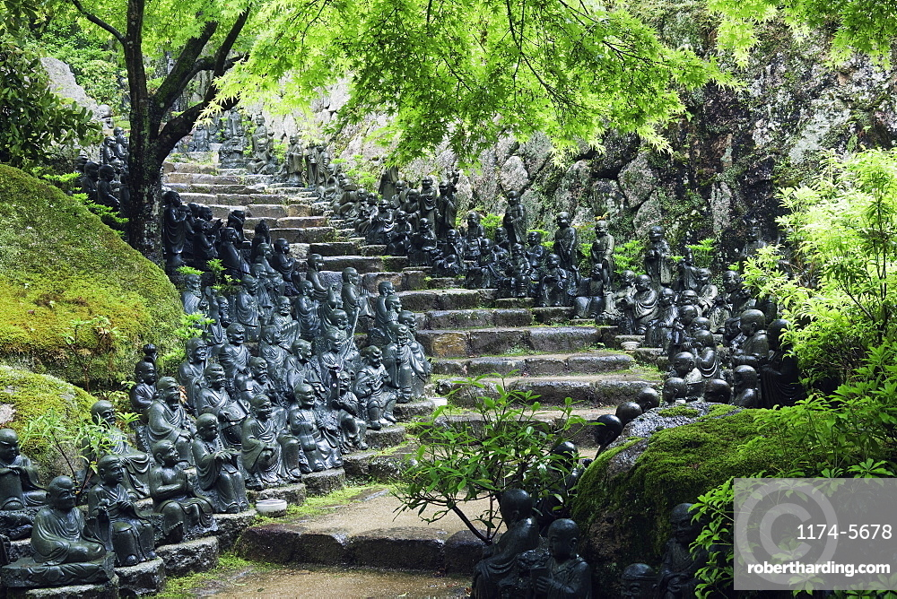 Statues lining steps in temple garden, Honshu island, Japan, Asia, Honshu island, Japan, Asia