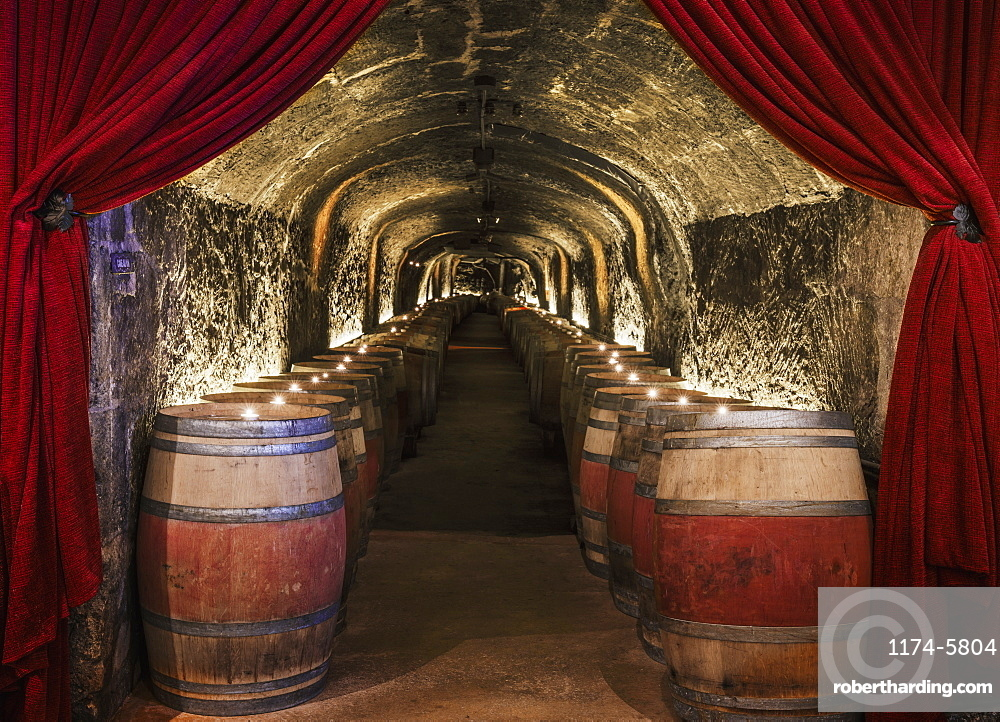 Candles on wine barrels in cave cellar, NAPA, California, USA