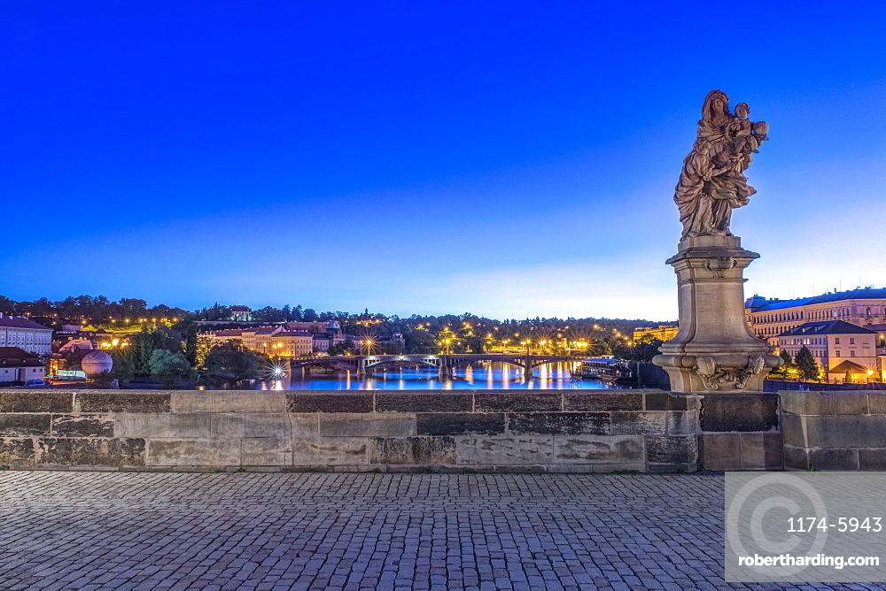 Statue and cobblestones on Charles Bridge at dawn, Prague, Czech Republic