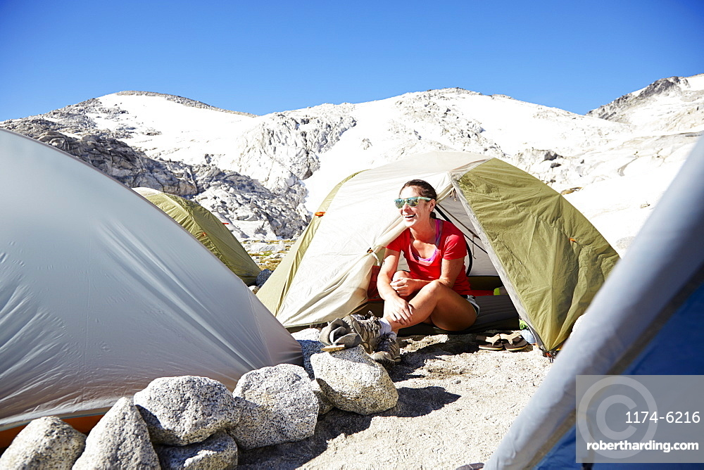 Hiker sitting in tent at campsite, Leavenworth, Washington, USA