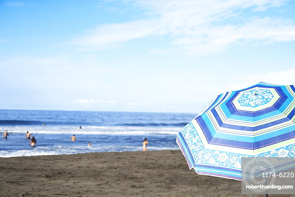 Umbrella on beach under blue sky, Tigaiga, Tenerife Canary Islands, Spain