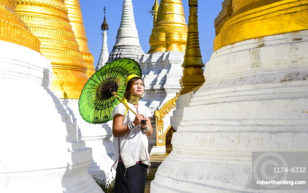 Asian woman carrying parasol at temple, Mingun, Mingun, Myanmar