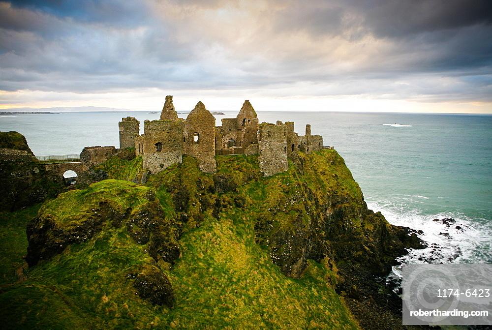 Castle ruins on cliff at ocean, Bushmills, Antrim, Ireland