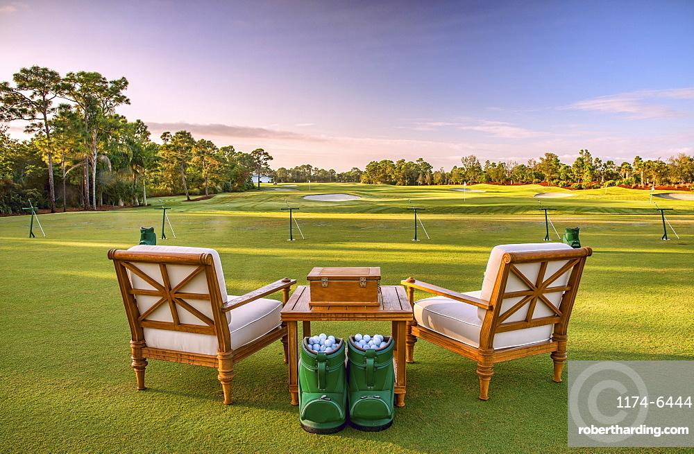 Chairs and golf balls on driving range, Stuart, Florida, USA