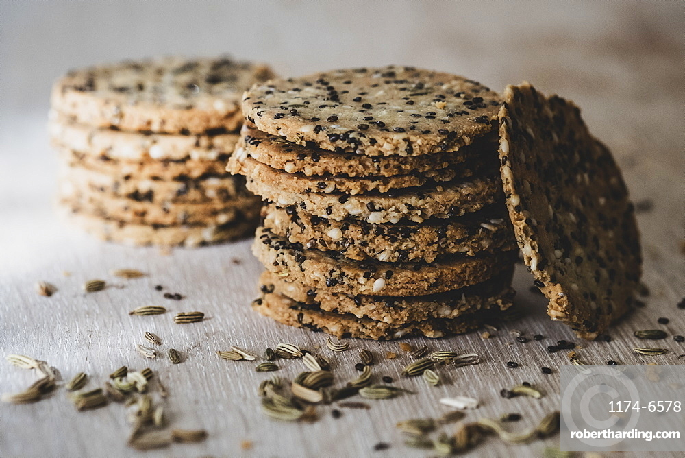 High angle close up of stack of freshly baked seeded crackers, England