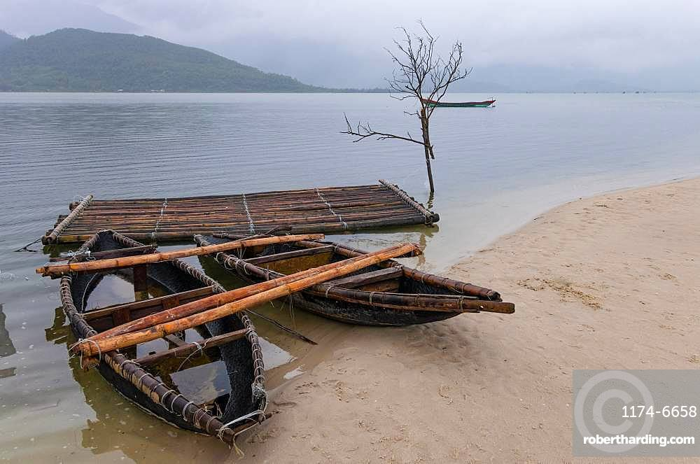 Traditional boats on sandy shore near Da Nang, Vietnam