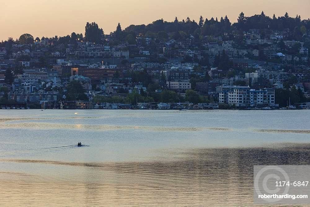 Crew racers rowing double scull boat on Lake Union at dawn, Seattle, Washington, United States of America