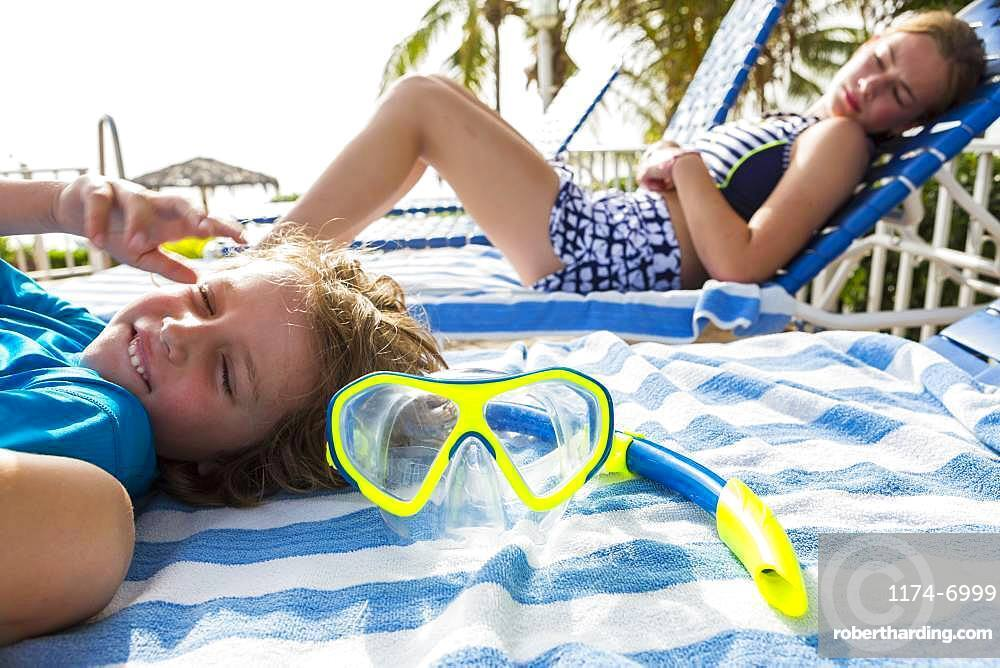 Snorkel face mask with children in the background, Grand Cayman, Cayman Islands