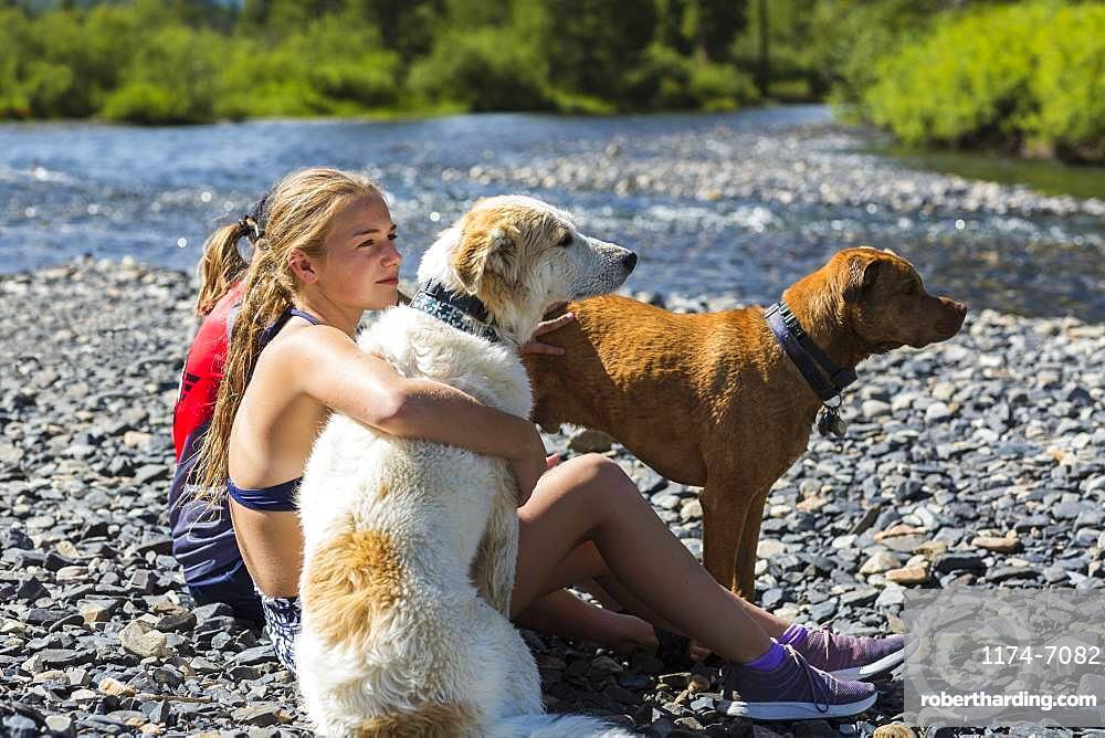 13 year old teen girl embracing her dog, Crested Butte, CO