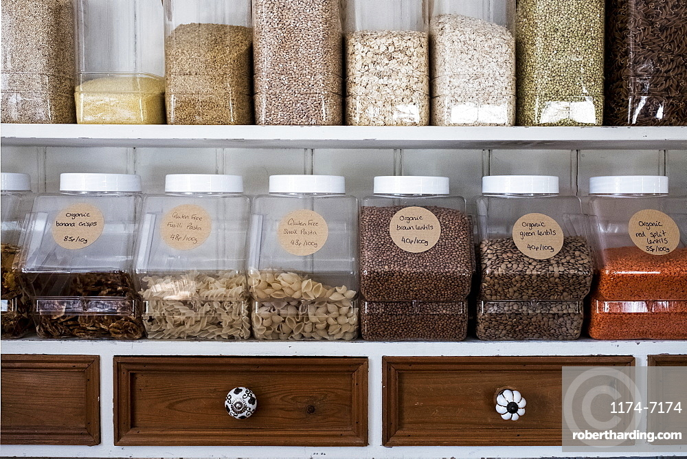 Close up of shelves with a selection of pasta, legumes and grains in glass jars