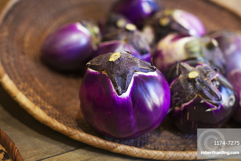 High angle close up of a selection of fresh purple aubergines in a farm shop, Kyushu, Japan
