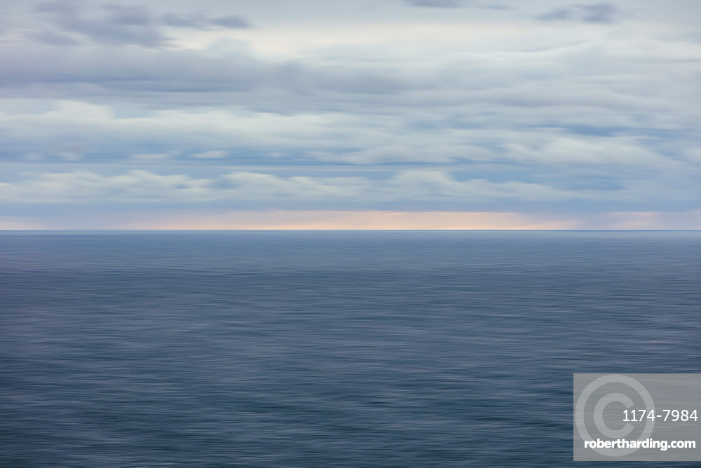 Blurred motion abstract of ocean, horizon and stormy sky at dusk, Oregon, United States of America