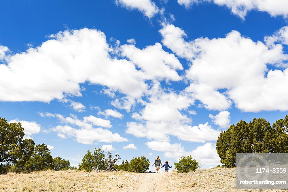 Brother and sister on hiking trail, Galisteo Basin, New Mexico, United States of America
