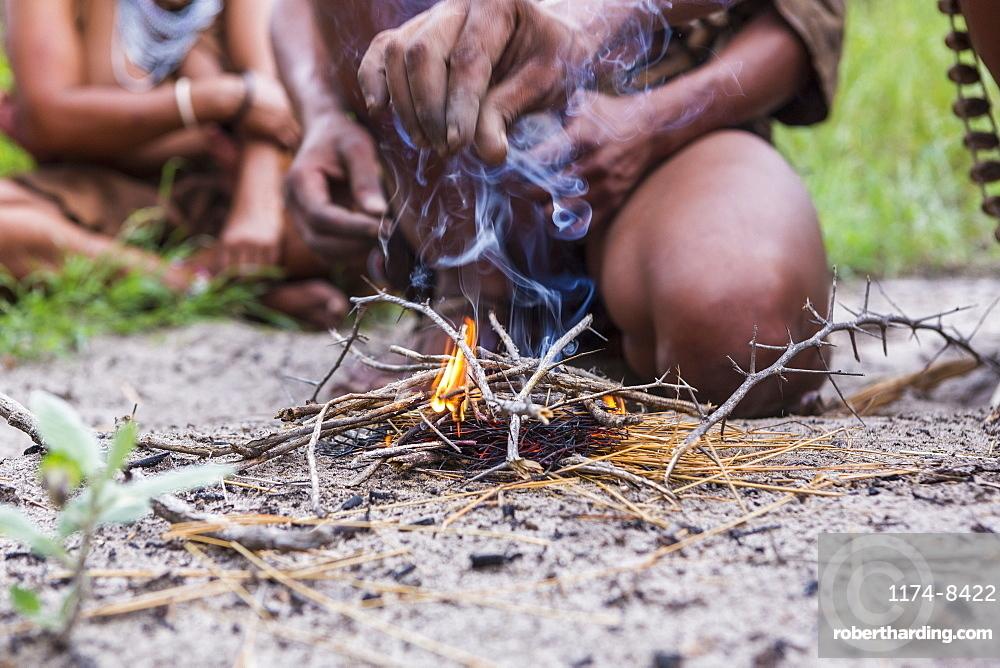 close up of Bushman creating fire, Botswana
