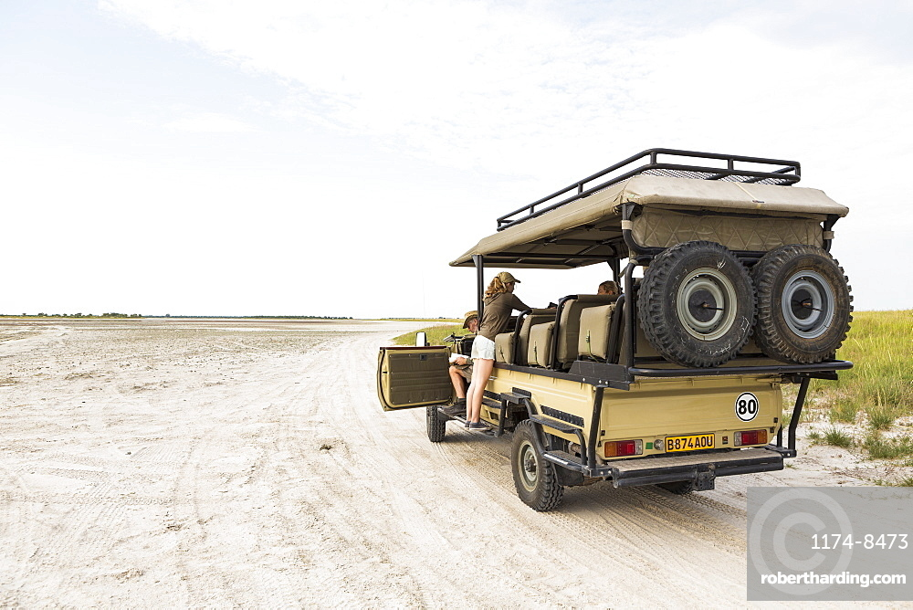 Thirteen year old leaning on safari vehicle, Botswana
