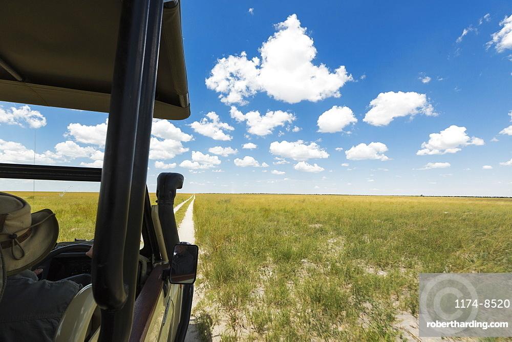 safari vehicle on dirt road, Botswana