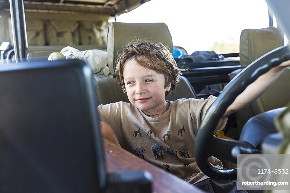 portrait of Six year old boy in safari vehicle