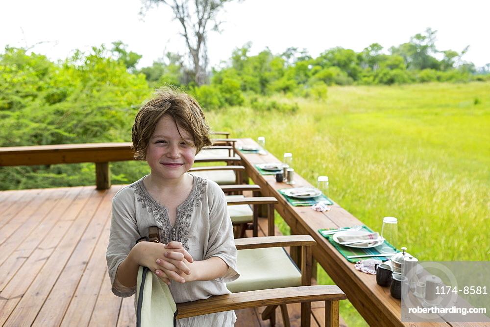Six year old boy overlooking a scenic landscape, Botswana