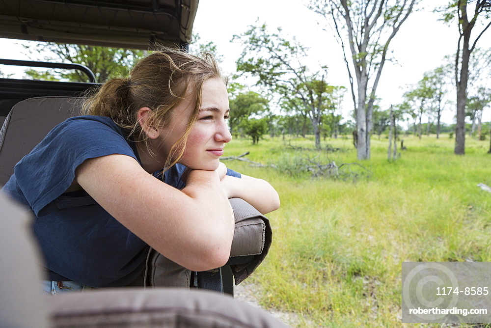 Thirteen year old girl in safari vehicle, Botswana