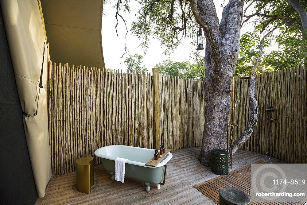 A outdoor bath tub in a tented safari camp, Botswana
