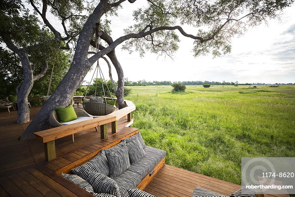 Wooden platform overlooking scenic landscape at a tented safari camp, Botswana