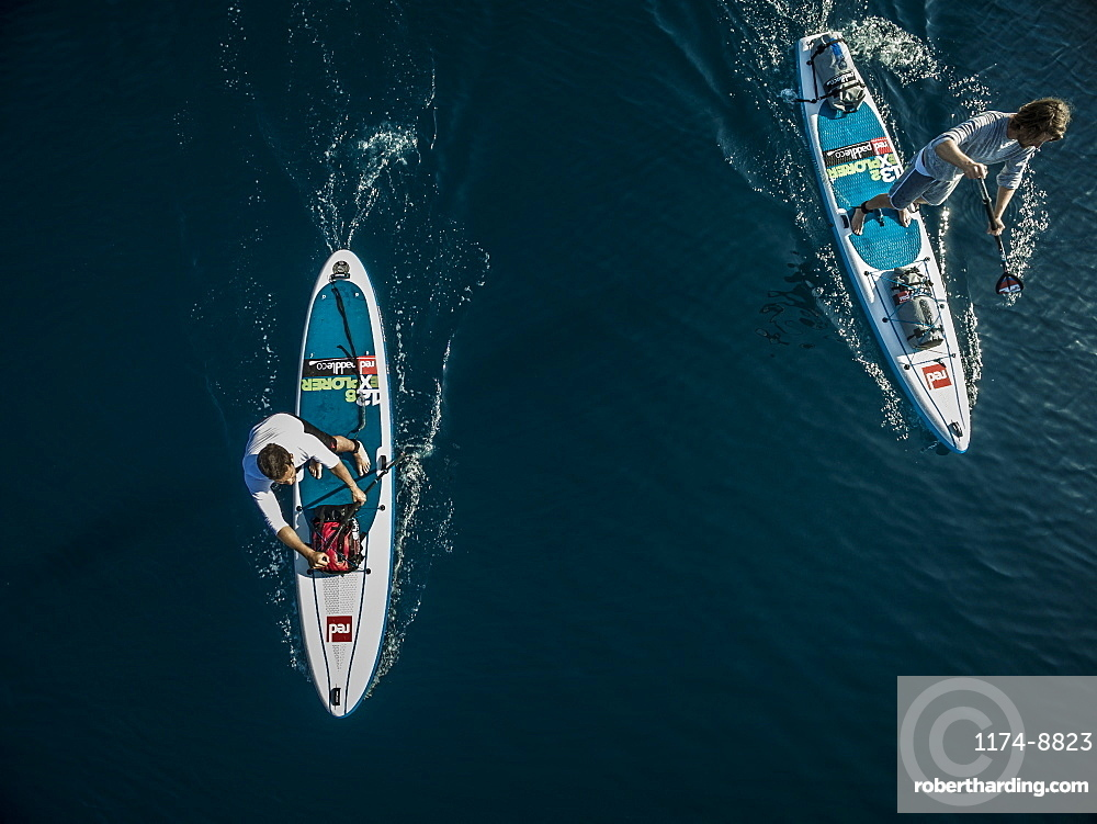 Aerial shot of two people on paddleboards