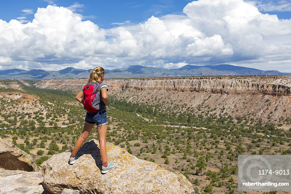 12 year old girl hiking in Tsankawi Runis, New Mexico