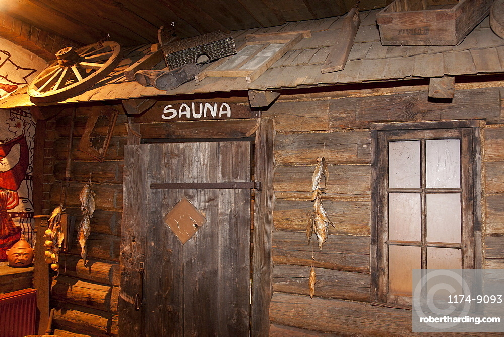 A hotel with old fashioned retro styled rooms and rustic objects, door to the sauna, Estonia