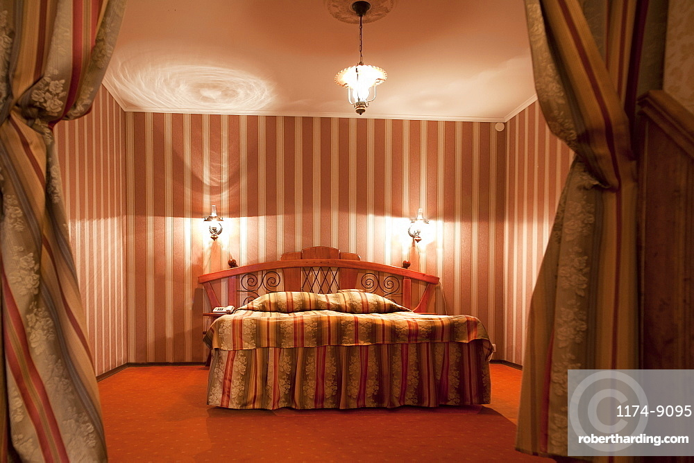 A hotel with old fashioned retro styled rooms, and rustic objects, Estonia
