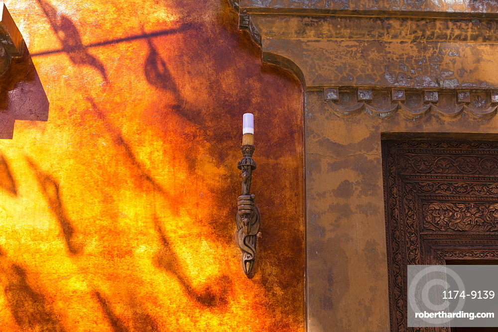 Close up of lamp and door frame of a building in Todos Santos, Mexico