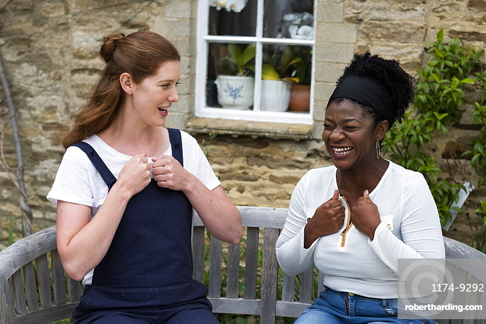 Woman and female therapist talking in a garden