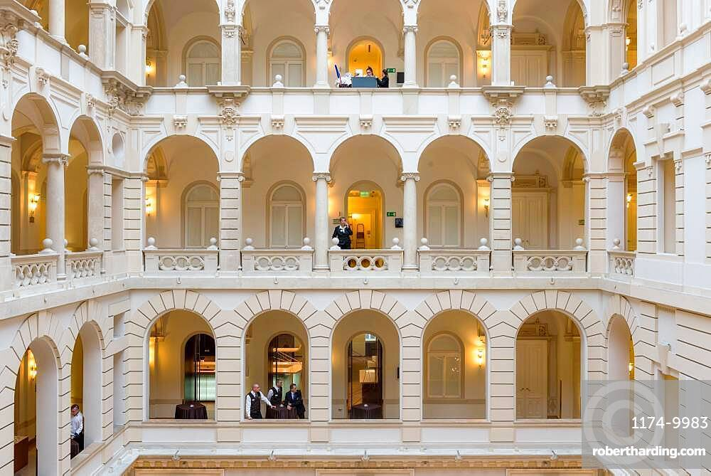 Hotel, a historic building with atrium and walkways, classical architecture, people on each level